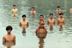 Zhang Huan - To Raise the Water Level in a Fishpond, 1997