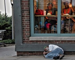 Ignorance is bliss – Homeless man sleeps outside a diner in Milwaukee
